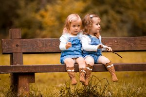 toddlers wearing fox socks on a bench - Cotswold Baby Co