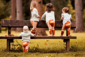 babies wearing fox leggings on a bench - Cotswold Baby Co
