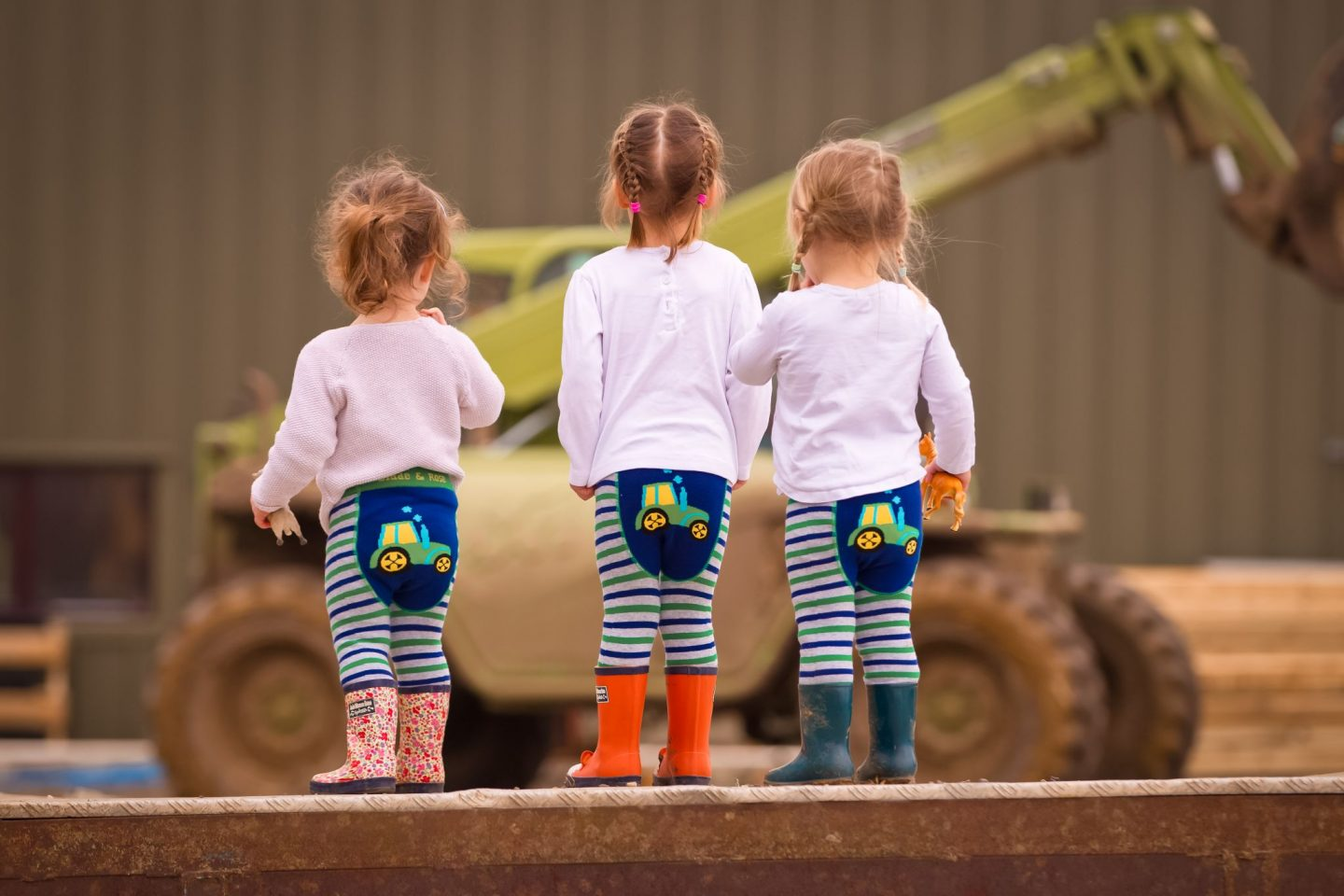little girls wearing tractor leggings by blade & Rose - Cotswold Baby Co