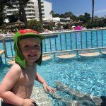 toddler-playing-in-swimming-pool