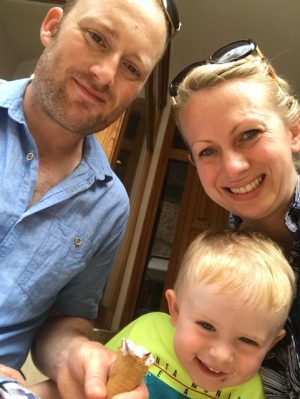 family sitting on plane - Cotswold Baby Co