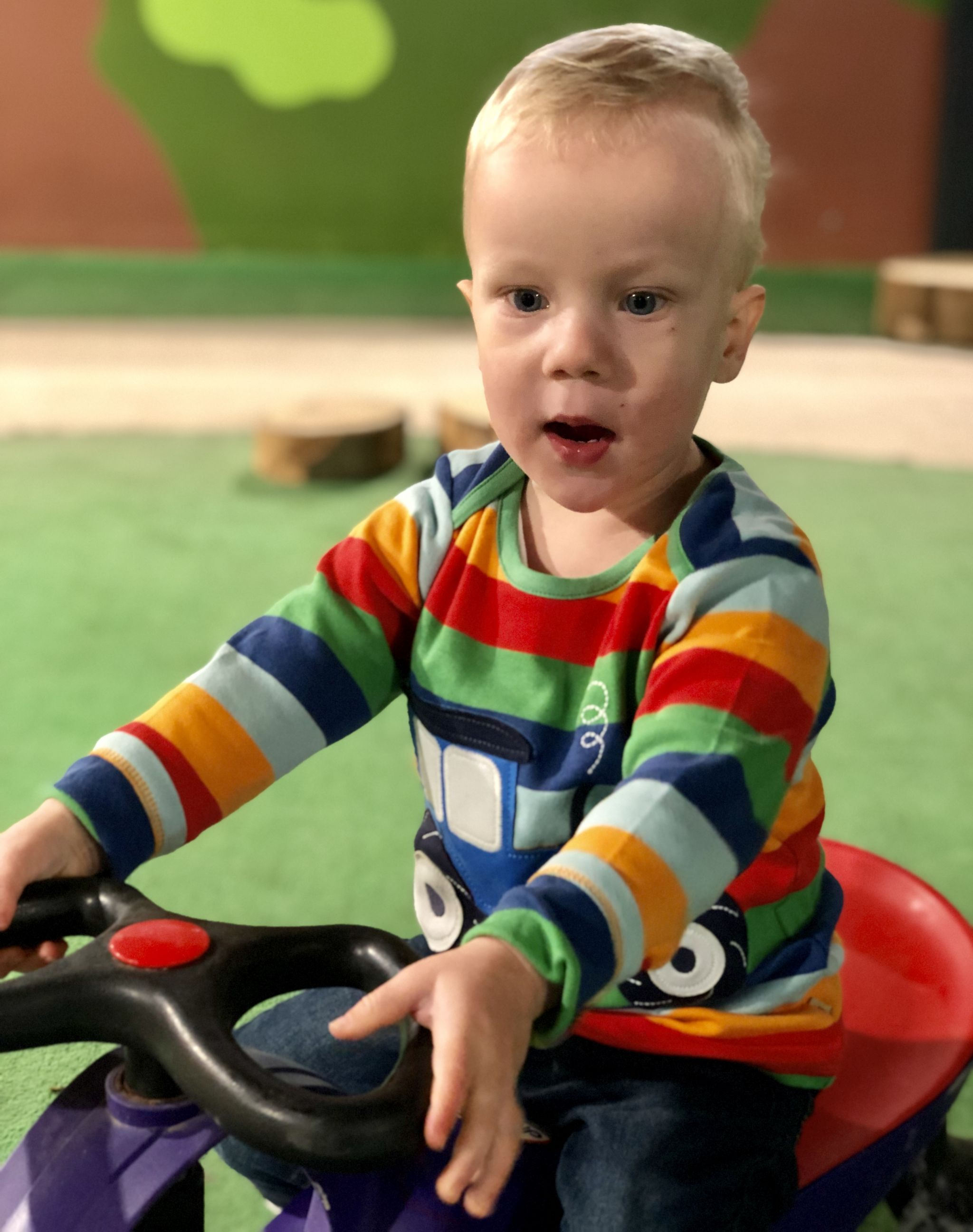 toddler wearing Frugi tractor top at Cotswold Farm Park, Cotswold Baby Co