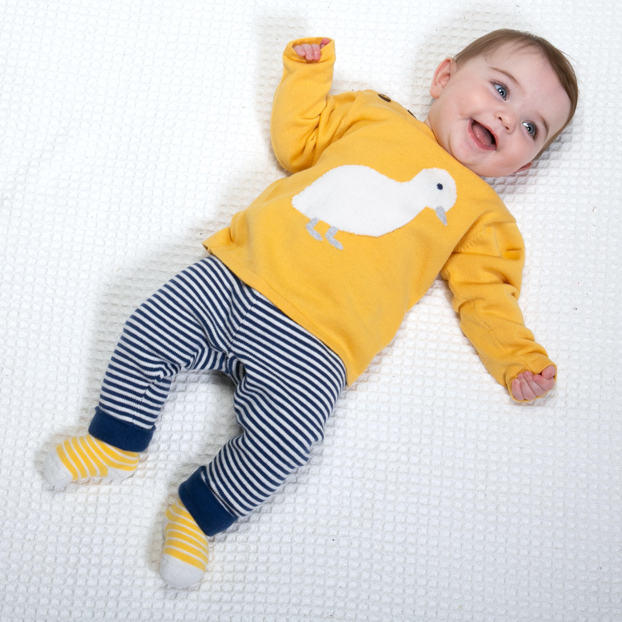Baby wearing Organic Cotton Little Duckling Knitted Set by Kite Clothing - Cotswold Baby Co