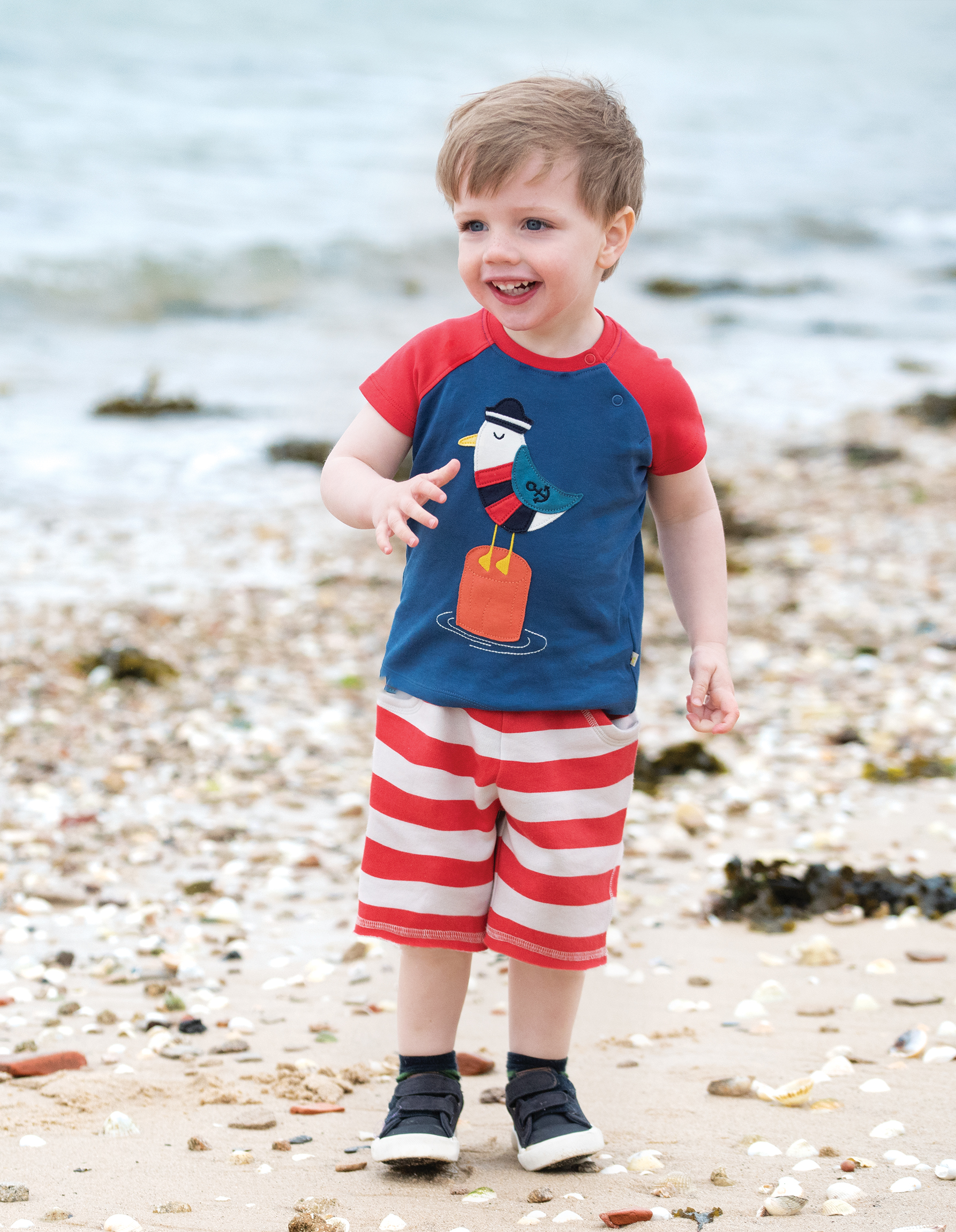 little boy wearing Renny Raglan Seagull outfit by Frugi - Cotswold Baby Co