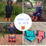 little boy wearing grass & air waterproofs from cotswold baby co